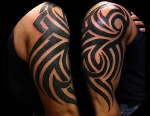 48 wonderful tribal tattoos for Tribal half sleeve tattoos