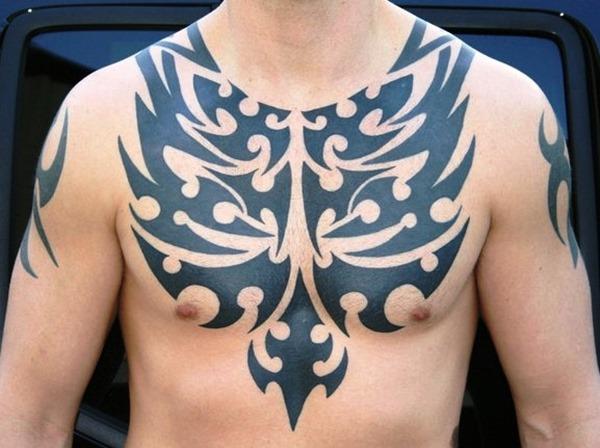 45 tribal chest tattoos for men for Black tribal tattoo ink