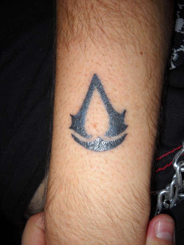Black Assassins Creed Logo Tattoo In Arm