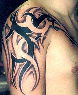 Grey And Black Tribal Designs Tattoo On Shoulder For Men