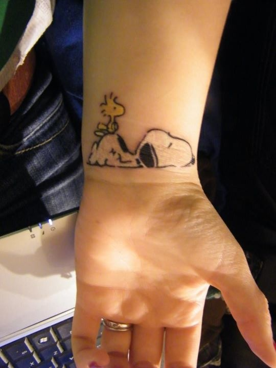 Nice Outline Snoopy Tattoo On Left Wrist