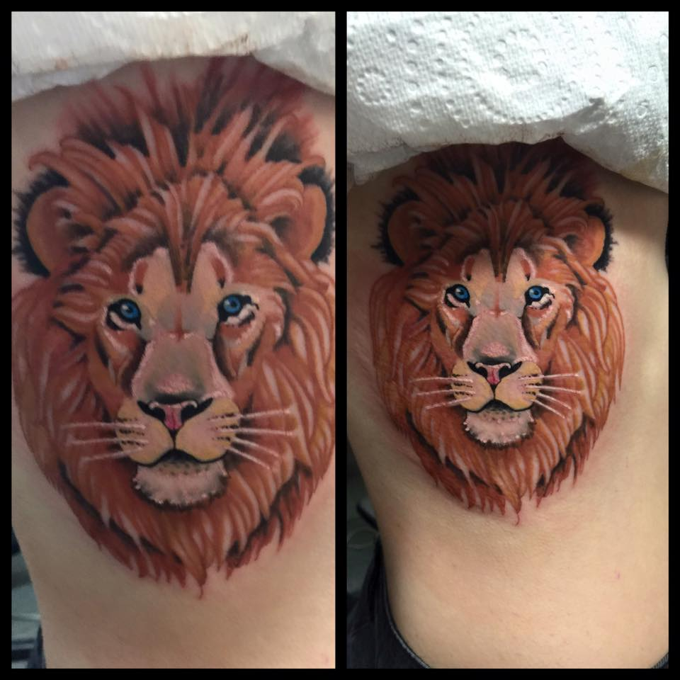 Small Lion Face Tattoo On Rib