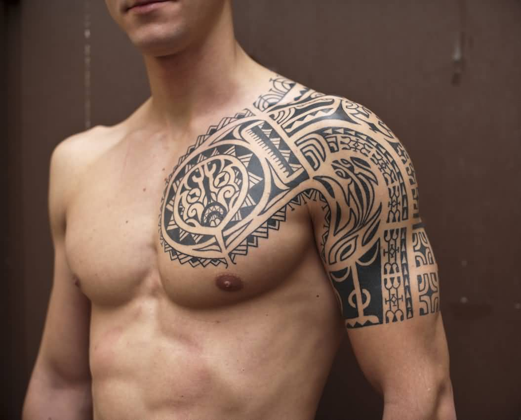 Polynesian tattoo on arm and chest - Superb Polynesian Tribal Tattoo On Left Chest And Shoulder For Men