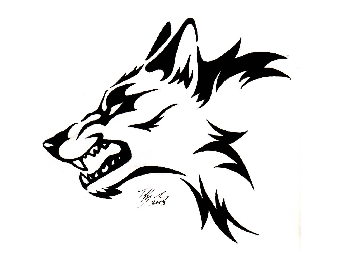 Tattoo design picture - Terrific Angry Tribal Wolf Head Tattoo Design