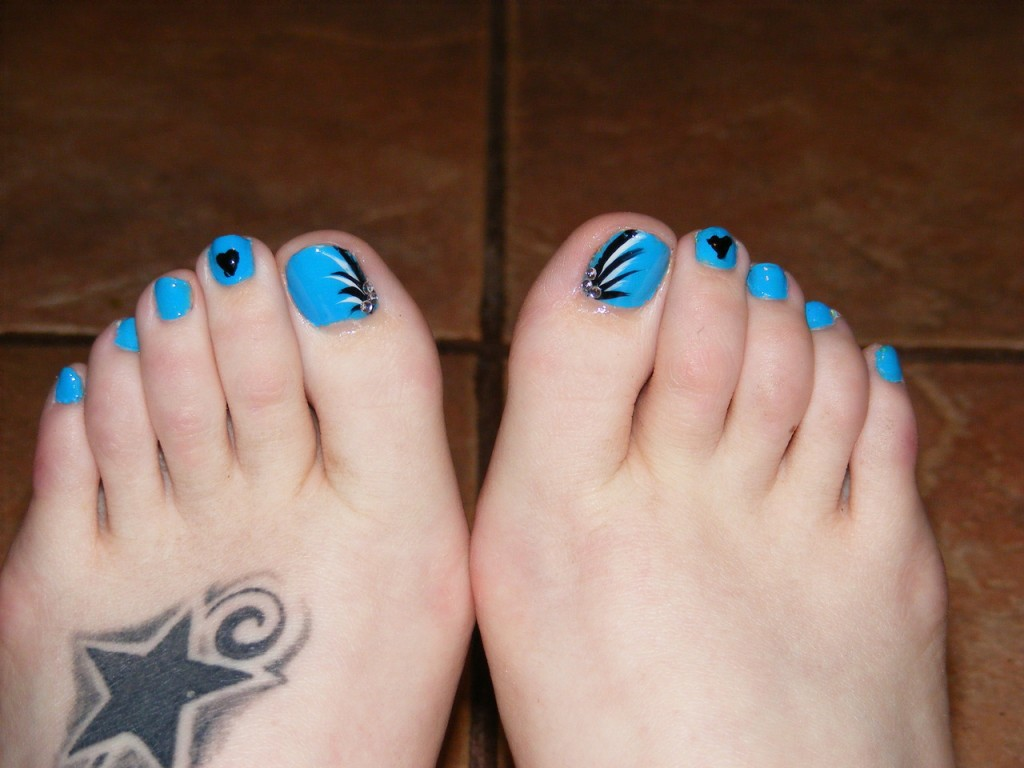 Blue Toe Nails With Black Flowers And Heart Design Nail Art