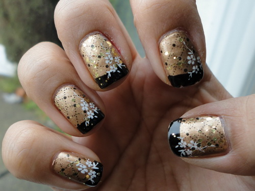 Gold nails with black tip and white flowers winter nail art prinsesfo Image collections