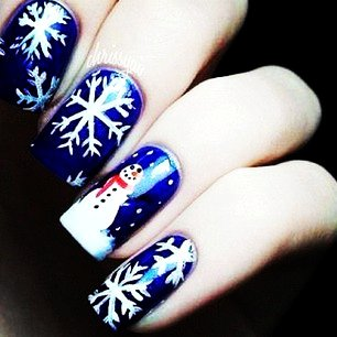 Navy Blue Nails With White Snowflakes And Snowman Winter Nail Art