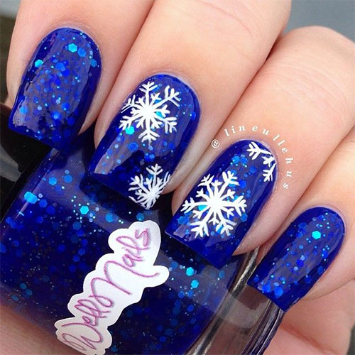 Navy Blue With White Snowflakes Winter Nail Art