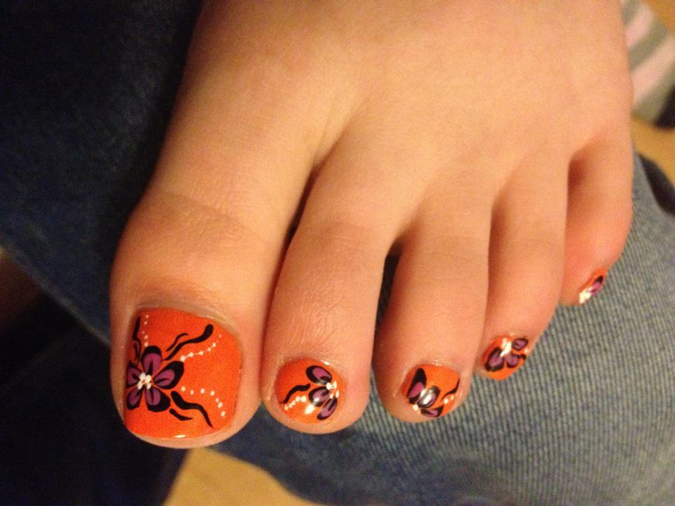 orange toe nails with purple flower design nail art