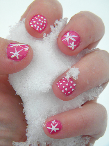 Pink Nails With White Dots And Snowflakes Design Winter Nail Art