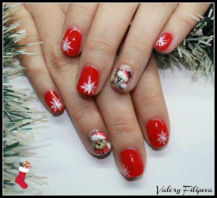 Red Nails With White Snowflakes And Bear Face Winter Nail Art