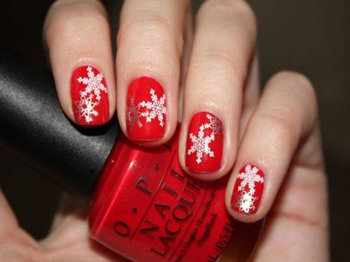 Red Nails With White Snowflakes Winter Nail Art