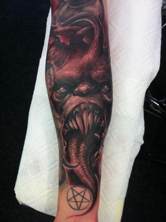 df49cc181 Scary Grey And Black Evil Face Tattoo On Arm Sleeve