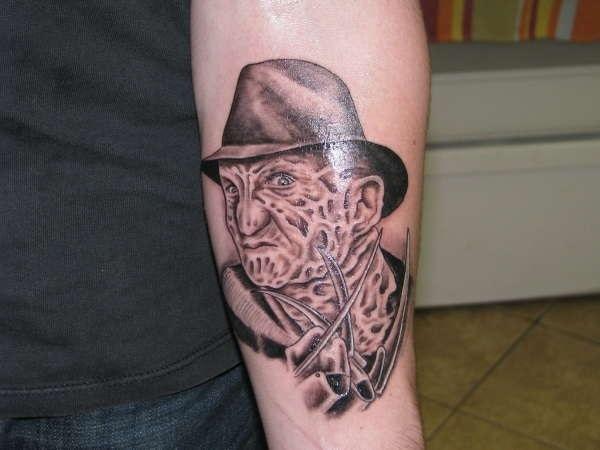 Small Grey Freddy Krueger Tattoo On Arm Sleeve