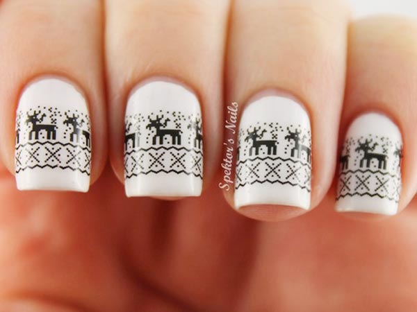 White Nails With Reindeer Design Winter Nail Art