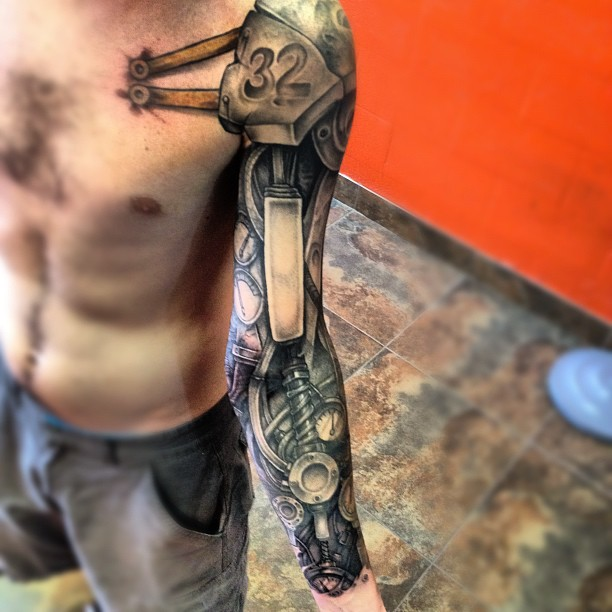 b379d42fbbbe9 Attractive Biomechanical Tattoo On Left Full Sleeve For Men