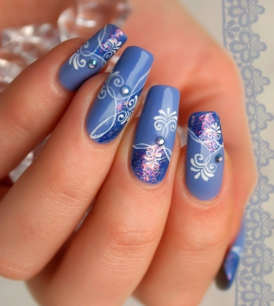 Blue Nail Art With White Flowers And Sparkle Design Idea