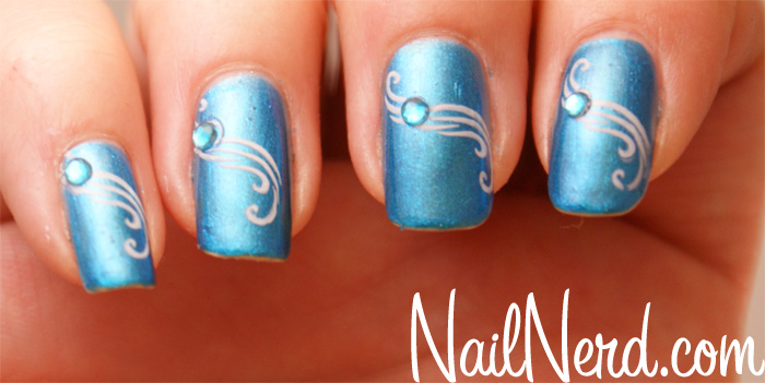 Blue Nails With Pink Spiral Design With Rhinestones Design