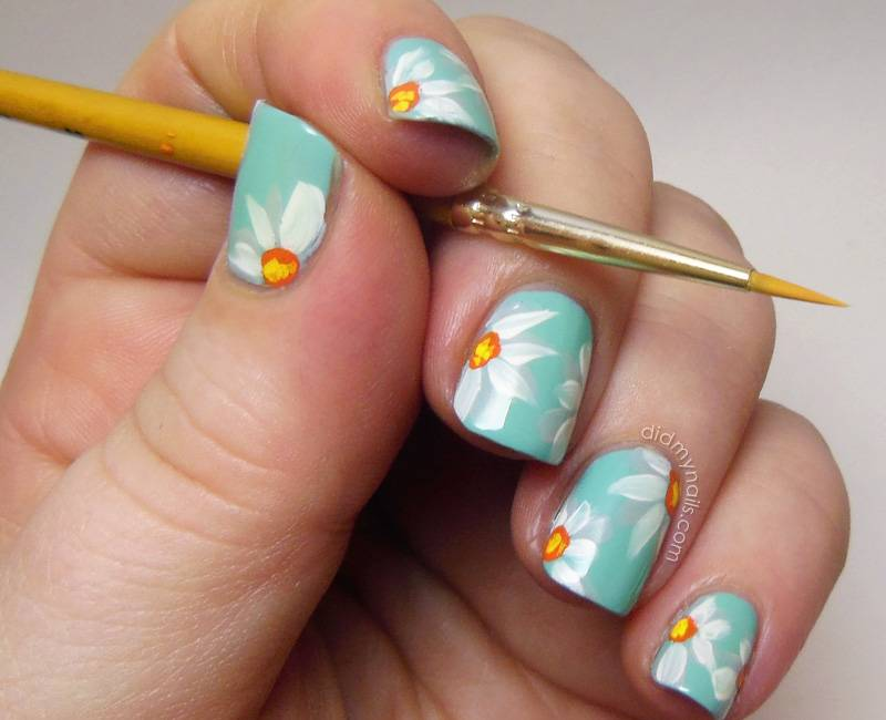 Blue Nails With White Flowers Nail Art