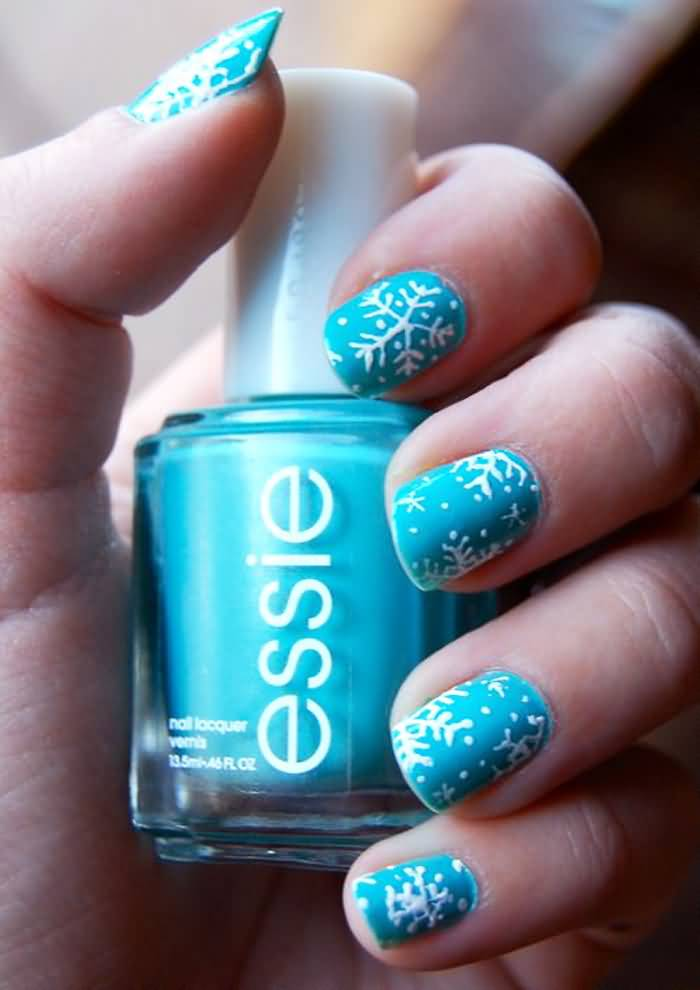 Blue Nails With White Snowflakes Design Idea