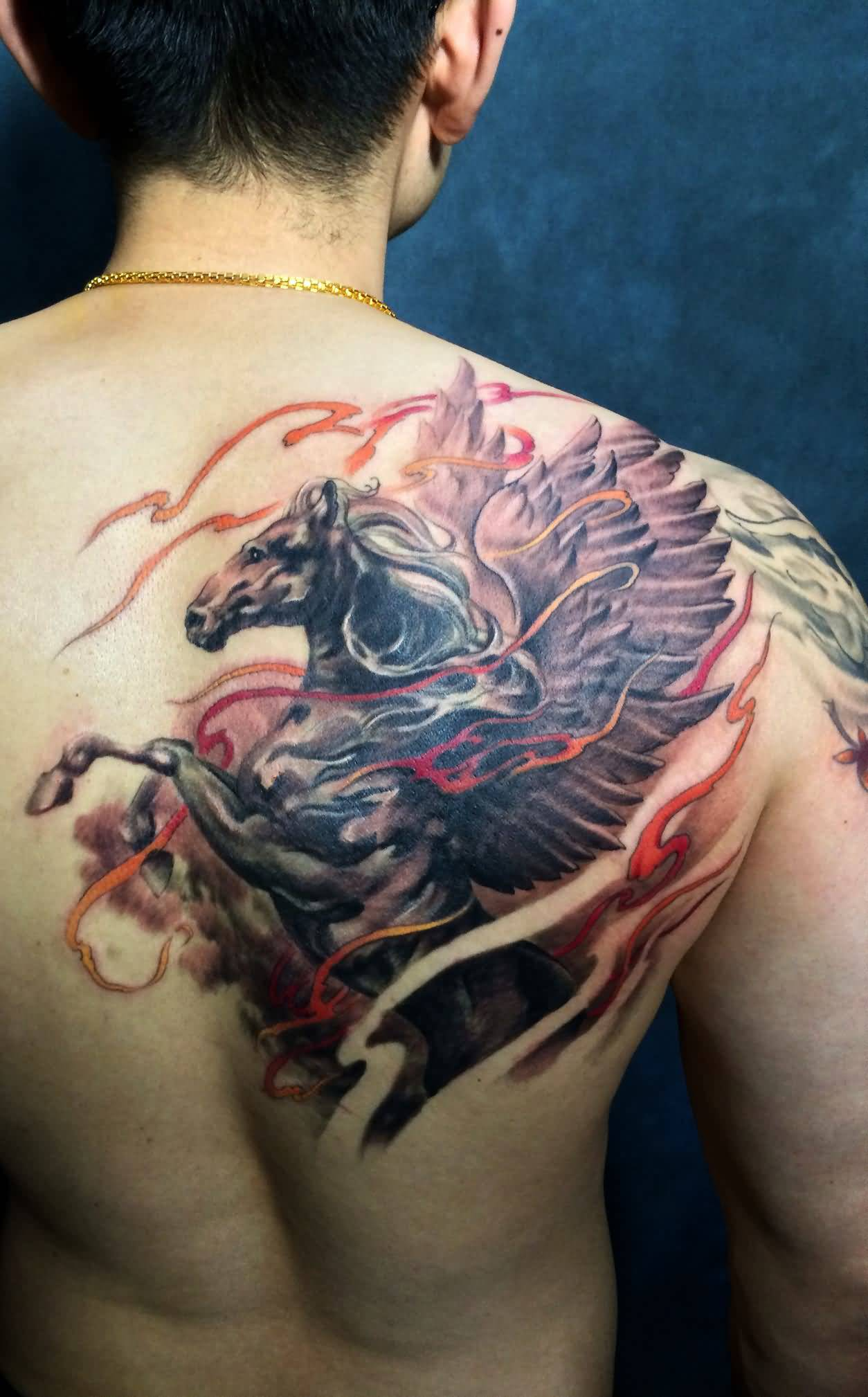 Brilliant colorful pegasus tattoo on upper back for Tattoo pitture