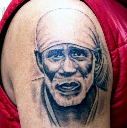 brilliant sai baba portrait tattoo on right shoulder. Black Bedroom Furniture Sets. Home Design Ideas
