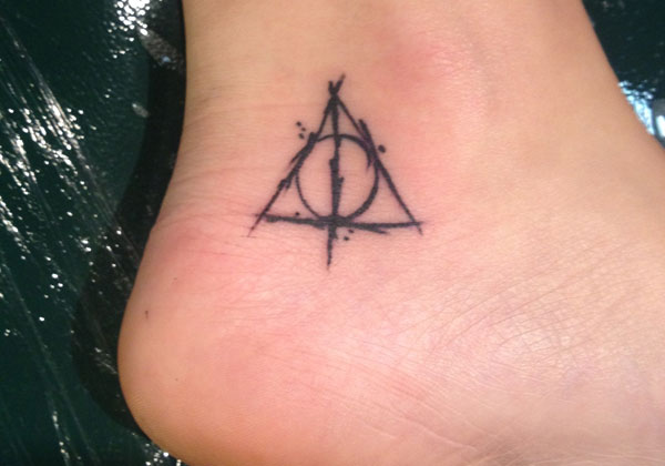 Black harry potter deathly hallows symbol tattoo on ankle for Unique small tattoos