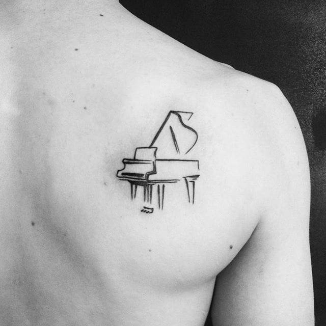 Cool Small Grand Piano Tattoo On Right Back Shoulder For Men