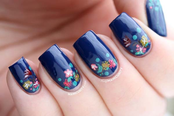 Dark Blue Glossy Nails With Flowers Design Idea