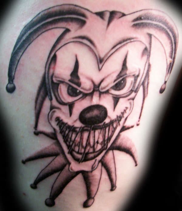 40 famous jester tattoos for Evil faces tattoos
