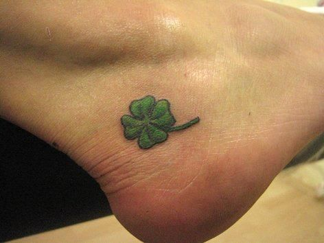 Lovely small four leaf shamrock tattoo on below ankle for Shamrock foot tattoo