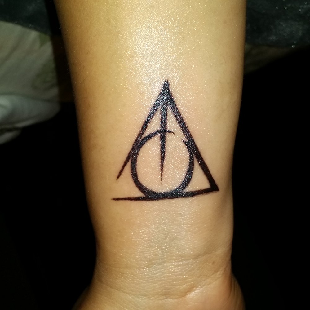 27 hallows tattoos on wrist