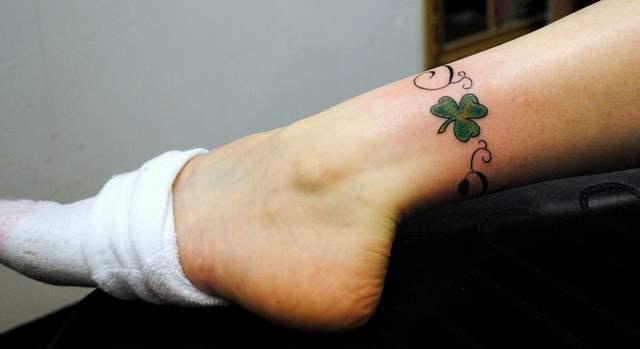 Nice small shamrock leg band tattoo for Shamrock foot tattoo