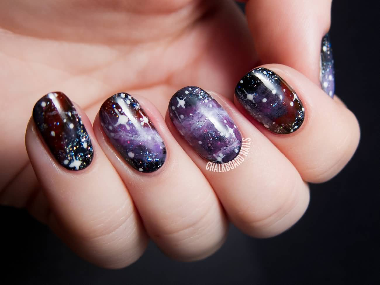 Purple And Red Galaxy Nail Art