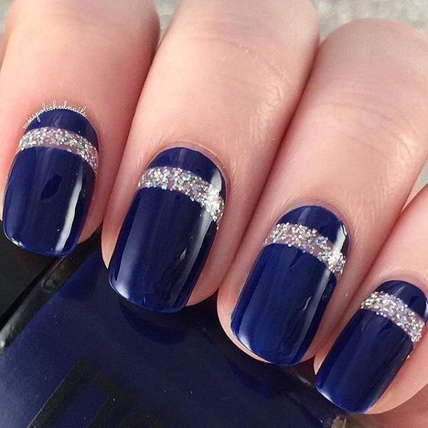 - Royal Blue Nails With Silver Glitter Stripes Design