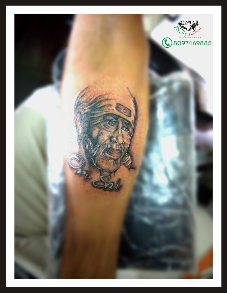 large sai baba face with rays tattoo on left half sleeve. Black Bedroom Furniture Sets. Home Design Ideas