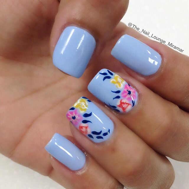 Sky Blue Nails With Flowers Design Idea