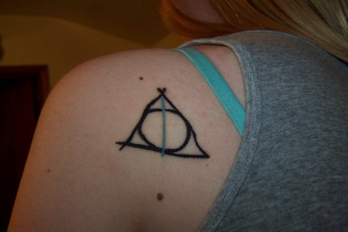 46 deathly hallows tattoos ideas terrible deathly hallows tattoo on back left shoulder buycottarizona