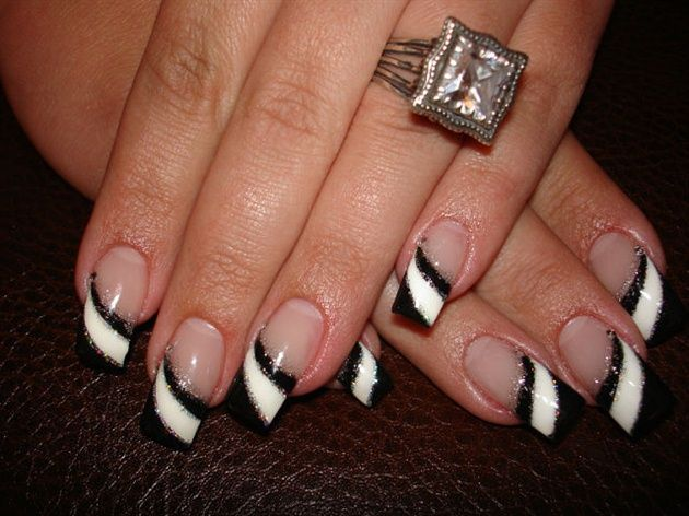 Black and white diagonal tips with glitter nail art design