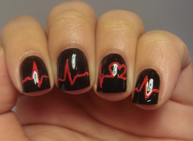 Black Glossy Nails With Red Acrylic Heartbeat Nail Art