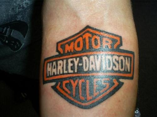 4decde813 Colored Harley Davidson Bike Logo Tattoo On Forearm