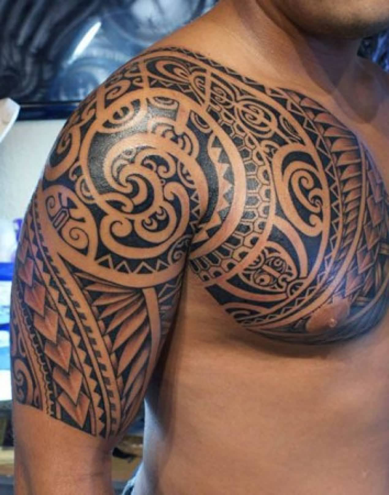 Brilliant Samoan Tribal Tattoo On Chest And Shoulder