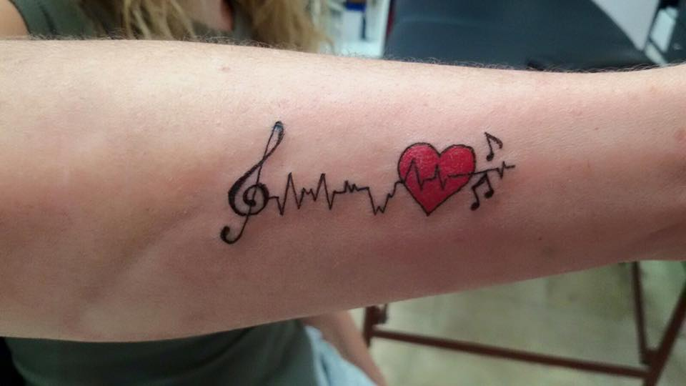 Small Red Heart And Heartbeat With Music Notes Tattoo On