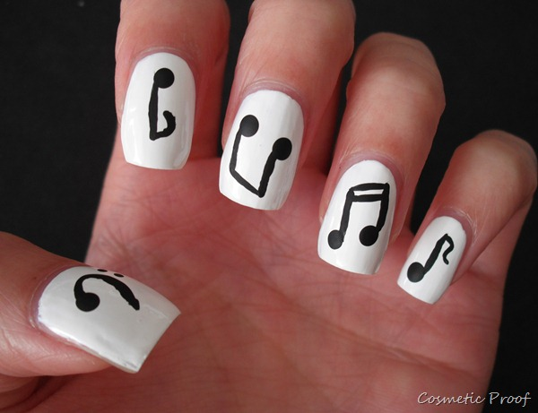 White Matte Nails With Black Music Notes Nail Art - 42+ Latest Music Nail Art Design Ideas