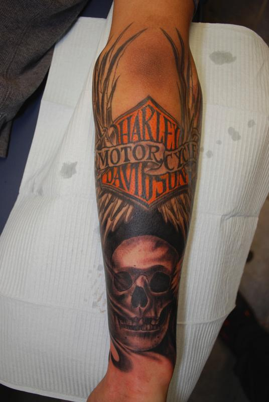 d60763901 Winged Harley Shield And Skull Tattoo On Forearm