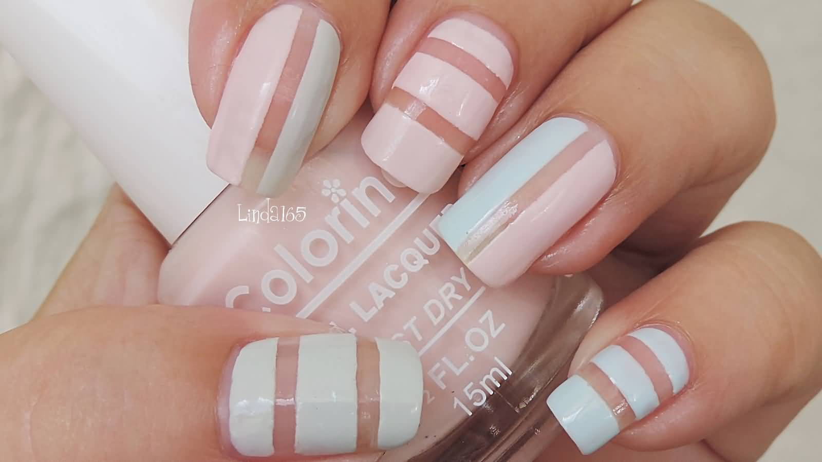 Baby Pink And Blue Negative Space Stripes Nail Art
