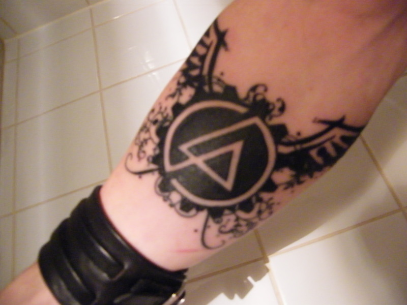black winged linkin park symbol tattoo on forearm. Black Bedroom Furniture Sets. Home Design Ideas