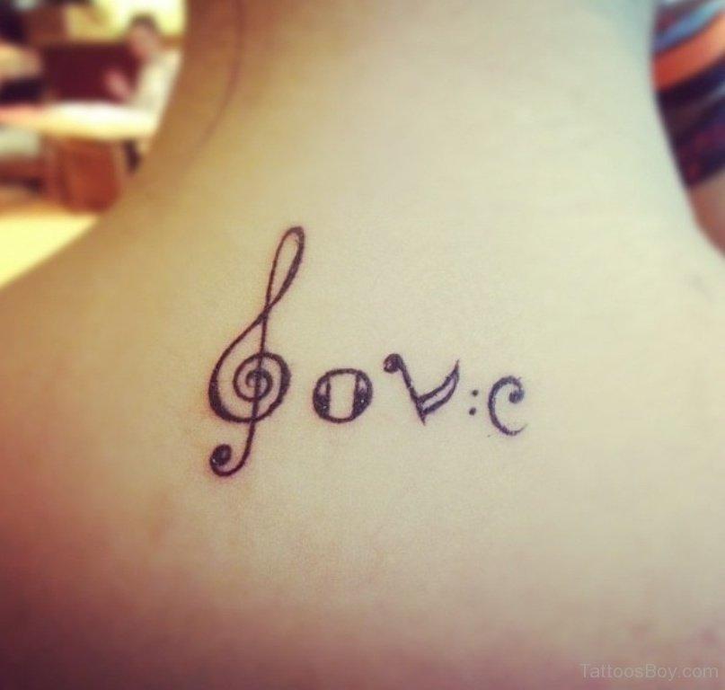 Cute Music Love Tattoo On Upper Back