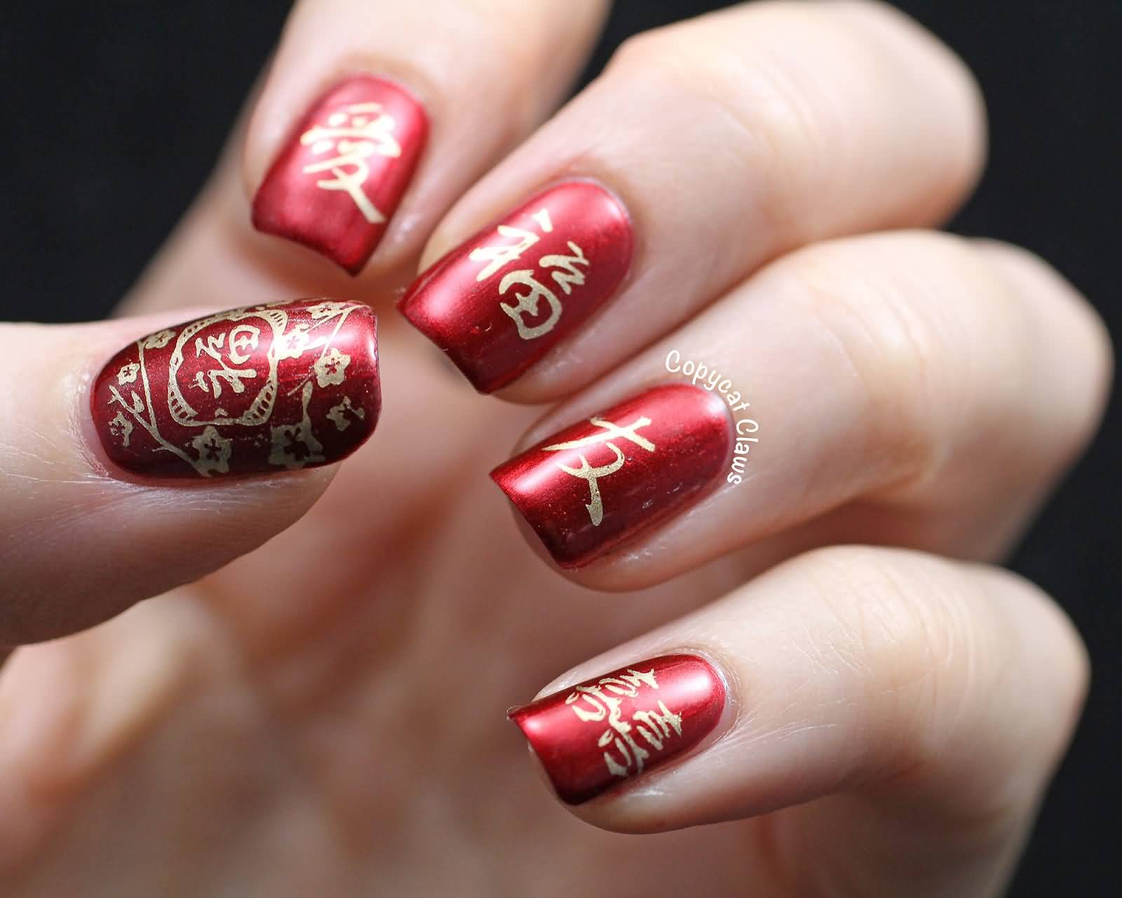 Golden Chinese Symbols Nail Art On Red Nails