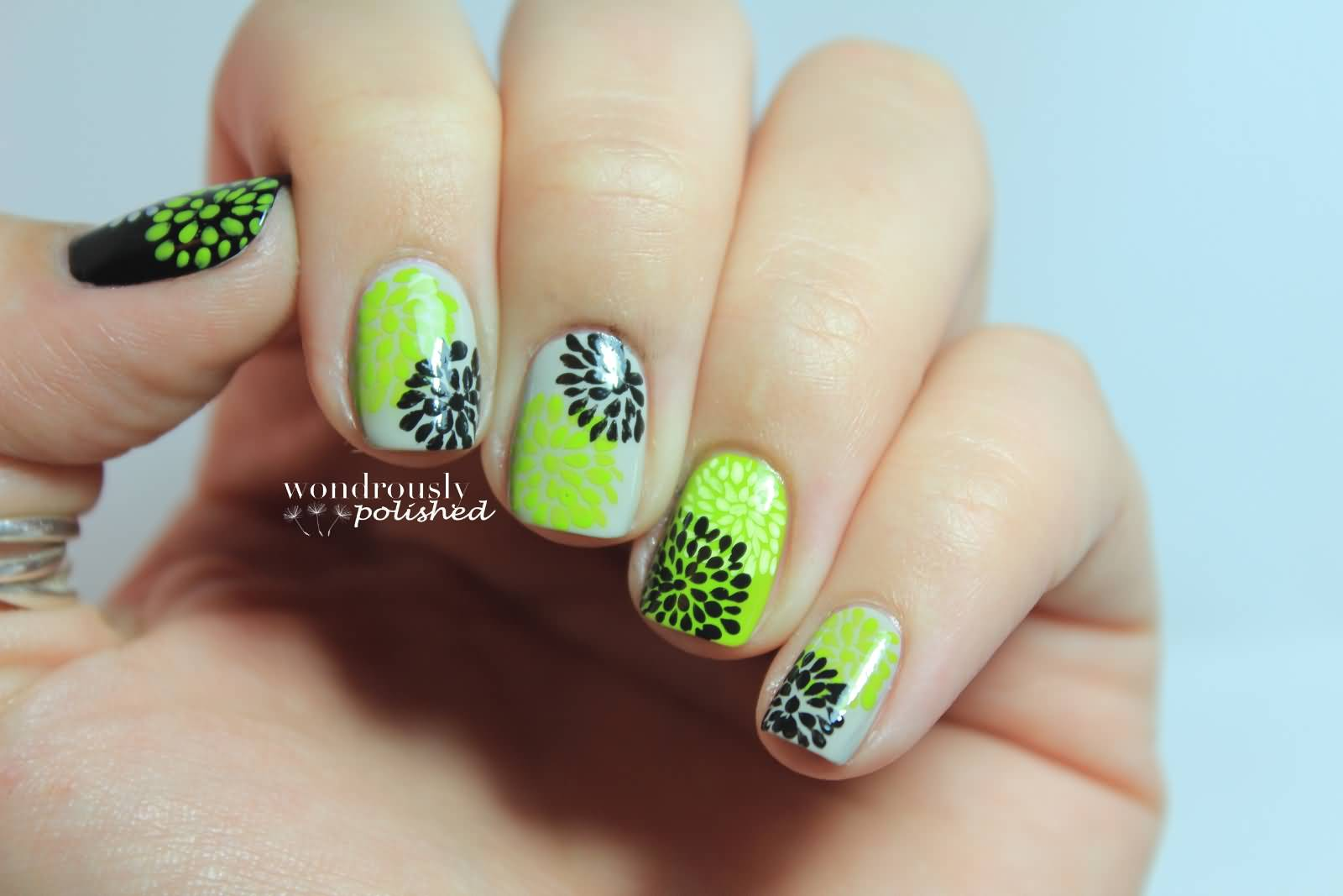 green and black flowers design nail art